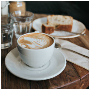 gourmet coffee and pastry on a plate - photo by alisa anton on www.unsplash.com