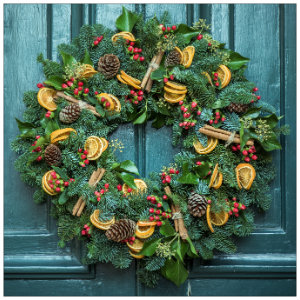 Beautiful green wreath with ornaments on a wall - image by jet times unsplash.com
