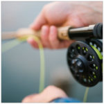 Up close shot of a fishing reel with green line - image by carl heyerdahl unsplash.com