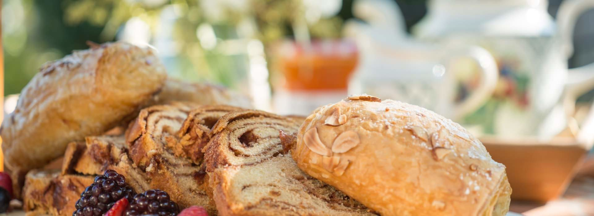 Close up view of a variety of pastries and bread