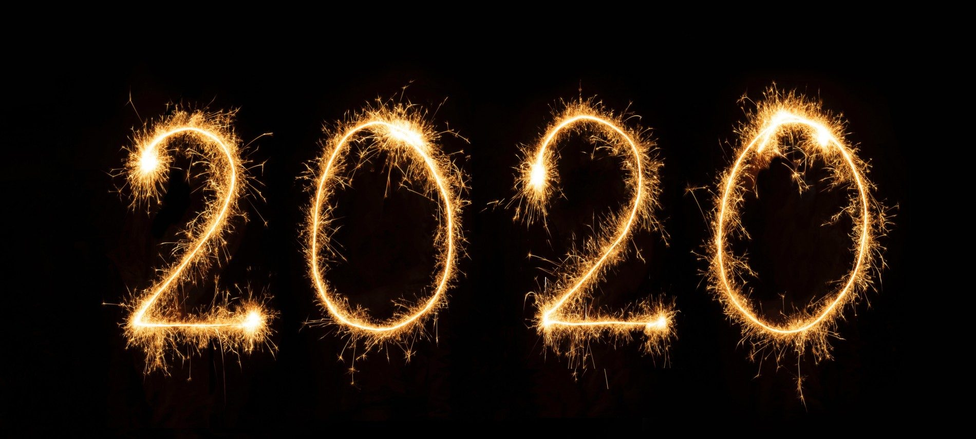 Dark black background featuring the numbers 2020 in gold sparklers